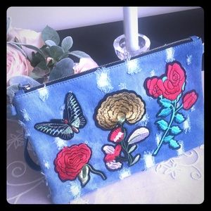 Handbags - Embroidered patch distressed denim clutch
